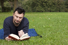 Young Adult Reading at the Park Stock Photography