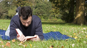 Young Adult Reading at the Park Stock Image