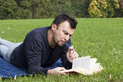 Young Adult Reading at the Park Royalty Free Stock Image
