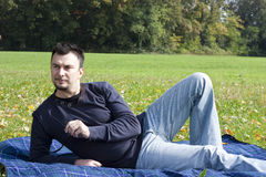 Young Adult Relaxing in the Park Stock Photo