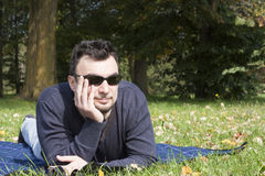 Young Adult Relaxing in the Park Stock Images
