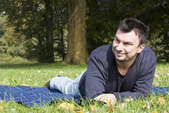 Young Adult Relaxing in the Park Royalty Free Stock Image