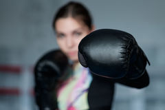 Young adult boxing girl posing with gloves. Stock Photo