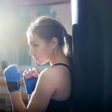Young adult boxing girl posing with gloves. Royalty Free Stock Photo