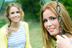 Young Adult  Sisters at the park Stock Photography