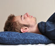 Young adult sleeps Stock Image