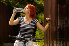 Young adult smiling biker woman on mounting bike Royalty Free Stock Images