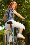 Young adult smiling biker woman on mounting bike Royalty Free Stock Image