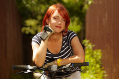 Free Young Adult Smiling Biker Woman On Mounting Bike Royalty Free Stock Photography - 16501517