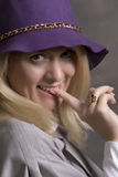 Young adult smiling woman. Young adult smiling attractive woman in hat Royalty Free Stock Image