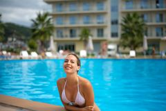 Young adult smiling woman in outdoor waterpool royalty free stock photo