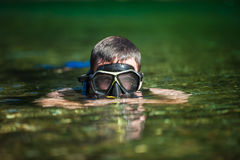 Young Adult Snorkeling in a river Stock Image
