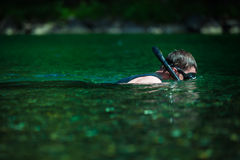 Young Adult Snorkeling in a river Stock Photography
