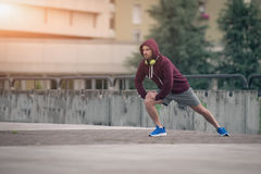 Young adult sportsman working out in the city Royalty Free Stock Images