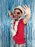 Young adult in a state of euphoria. Caucasian man in red clothes. Young adult is very happy. Crazy pose, funny. Caucasian man in red sunglasses. Funny. Euphoria Stock Photos