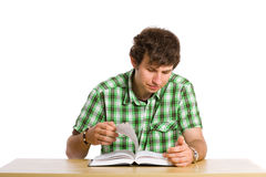 Young adult student look through the book Stock Photo