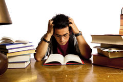 Young adult student reads book Stock Photography