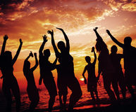 Young Adult Summer Beach Party Dancing Concept Stock Photos