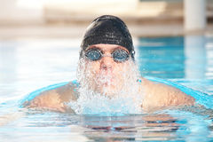 Young adult swimmer Stock Images