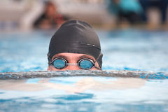 Young adult swimmer Stock Image