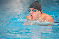 Young adult swimmer stock photo