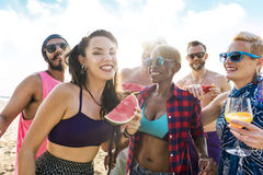 Young adult together on the beach party royalty free stock image