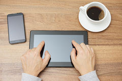 Young adult is typing with two fingers on tablet computer, top v Royalty Free Stock Image