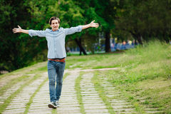 Young adult walking alone in park royalty free stock photography