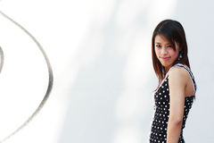 Young Adult Woman. An attractive young woman in front of a white wall Stock Images