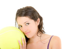 Young adult woman with big  tennis ball Royalty Free Stock Images