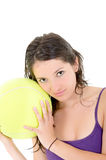 Young adult woman with big  tennis ball Stock Photography