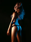 Young adult woman in black lingerie shooting from behind Royalty Free Stock Image