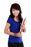 Young adult woman with a book Royalty Free Stock Images