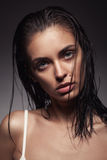 Young adult woman with clean fresh skin and wet hair Royalty Free Stock Image