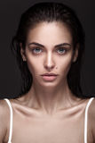 Young adult woman with clean fresh skin and wet hair Royalty Free Stock Photos