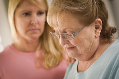 Young Woman Consoles Senior Adult Female Royalty Free Stock Images