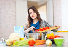 Young adult woman cooking veggie lunch Stock Images