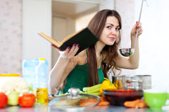 Young adult woman cooking veggie lunch Stock Photos