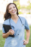 Young Adult Woman Doctor or Nurse Holding Touch Pad Outside Royalty Free Stock Photos