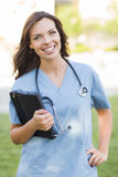 Young Adult Woman Doctor or Nurse Holding Touch Pad Royalty Free Stock Images