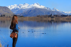 Young adult woman enjoy lake view Royalty Free Stock Image