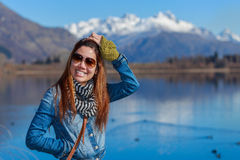 Young adult woman enjoy lake view Royalty Free Stock Images