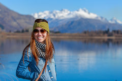 Young adult woman enjoy lake view Royalty Free Stock Photo