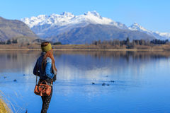 Young adult woman enjoy lake view Stock Photography