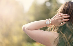 Young adult woman enjoying the bright day outdoors Royalty Free Stock Photos