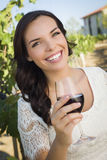 Young Adult Woman Enjoying A Glass of Wine in Vineyard Royalty Free Stock Images