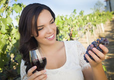 Young Adult Woman Enjoying A Glass of Wine in Vineyard Stock Image