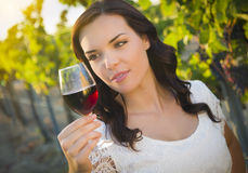 Young Adult Woman Enjoying A Glass of Wine in Vineyard Stock Photography