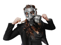 Young adult woman and gas mask Royalty Free Stock Images