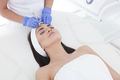Young adult woman having a mesotherapy treatment. Does anyone ready for mesotherapy? Let`s go for some beauty treatment Stock Photos